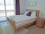 Bedroom 1 with double bed and quality oak furniture