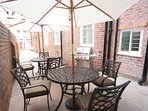 Courtyard complete with BBQ, Tables/Chairs & Parasols