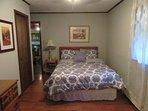 Grey bedroom with queen size bed