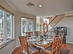 Gather around the gorgeous dining room table with you companions.