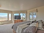 The master bedroom features plenty of space and a cozy king-sized bed.