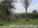 Front garden seating area with view over Bantry Bay in distance.