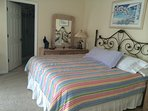 Bright, comfortable master bedroom with King bed and private bathroom