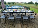 Dine outside overlooking the pool and countryside