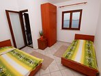 Double single bed room with open sea view, enter to smaller balcony