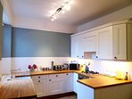 This spacious kitchen/diner is fully equipped for preparing light snacks to full roast dinners.
