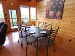 Dining Table with seating for 6 people and enjoy a beautiful view of the Smoky Mountains.