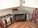 Designer Kitchen accessories including Kettle, Toaster & Microwave.