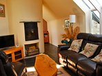 Living Room with real logburner and HD TV. Beautifully cosy and stunning views across another pond.