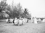 Wedding guests dine beachside