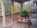 back deck with grill and rocking chairs