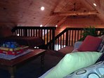 large upstairs loft-2 twin beds,2 big stuffed chair twin sofa beds,game/play area. Or sitting area