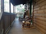 front deck with wrap around upper deck. Lower deck with hand crafted wood swing