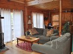 Large open living area/kitchen with hand carved stone, wood burning fireplace. Minutes from town