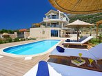 Relax on the deck  chairs  or enjoy the swimming at your private pool!