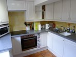 Well stocked kitchen/diner. Electric touch control hob/ electric oven/ washer/dryer. Ample crockery.