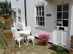 Front of Weavers Cottage, a great place to sit, relax and watch the world go by! Perfect location.