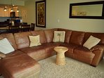 Living room with comfortable leather sofa set including a relaxing ottoman