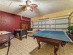 game room with table tennis topper on pool table
