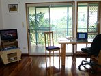 work space and TV in sitting room