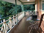 large deck with external power point and garden/sea views