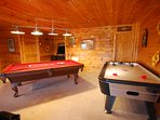 Game Room: 8' tournament style Pool Table and Air Hockey Table, and Arcade Game with 60 video games.
