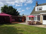 private enclosed south facing garden with bbq gazebo, swing chair etc.