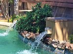 New pool waterfalls.