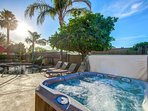 Jetted hot tub set to 101* and pool side loungers