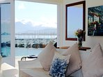 The views living room and balcony in the background over looking the Old Gordon's Bay Harbour.