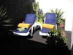 sun loungers in garden