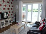 Sitting Room with French Doors out to the spacious balcony with river views and private Hot Tub