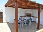 BBQ area with covered pagoda and outside dining table and chairs