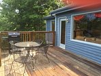 spacious back deck has a charcoal grill, bistro seating for 4 and a new hot tub!