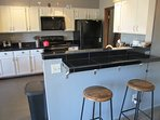 Granite tile counter tops & bar look great and will add enjoyment to every meal.