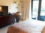 Elegant, spacious master bedroom has flatscreen TV