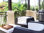 Relax, enjoy the view over the golf course and tropical greenery. Note BBQ area