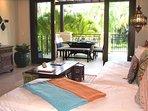 Door from living area to terrace opens wide for indoor/outdoor entertaining.