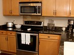 Kitchen with all stainless steel appliances and granite counter tops.