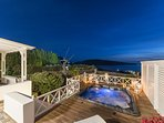 Endless view to Oia's famous sunset from the front yard of this luxury property.