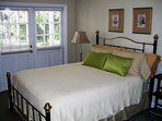 Queen size bed.  French doors to deck.
