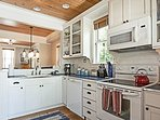 Gourmet kitchen with a rice cooker, food processor/blender, griddle, and copper bottom pans