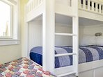 Two sets of built-in XL twin bunk beds with pillow-top mattresses