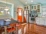 Kitchen and Dining with retro decor chairs