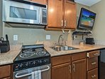 Stainless Steel Appliances With TV By The Kitchen