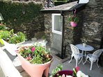 Lakeland Cottage's own private patio courtyard garden,  Windermere, the Lake District National Park.