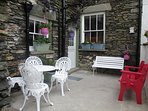 Lakeland Cottage's own private courtyard patio garden, windows to ground floor bedroom and kitchen.