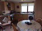 Kitchen/living area (includes electric hob & oven, dishwasher, fridge freezer, washing machine)