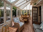 Dining area for eight in the Orangery overlooking the garden