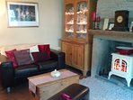 Lounge has antique Victorian pine furniture and exposed stonework